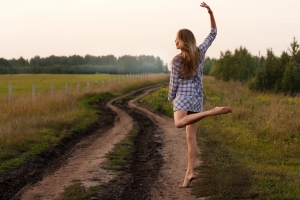 young-girl-dancing-happy-in-a-field-1386580-m